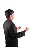 Uomo d'affari con le palme in su Immagini Stock