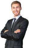 Uomo d'affari con le sue braccia attraversate Immagini Stock