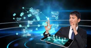 Uomo d'affari con lo schermo virtuale commovente del PC della compressa Fotografie Stock