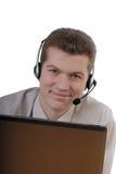 Uomo d'affari con lo speakerphone Fotografia Stock