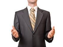 Uomo d'affari con spazio fra due mani Immagini Stock
