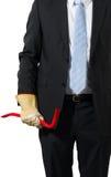 Uomo d'affari con un bastone a leva Immagine Stock