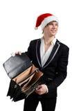 Uomo d'affari con un cappello del Babbo Natale Fotografia Stock