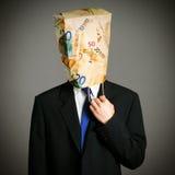 Uomo d'affari con un sacco di carta sulla testa Fotografie Stock