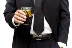 Uomo d'affari con una bevanda Fotografie Stock Libere da Diritti