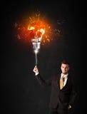 Uomo d'affari con una lampadina di esplosione Fotografia Stock Libera da Diritti