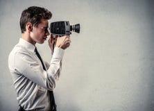 Uomo d'affari con una macchina fotografica Fotografia Stock