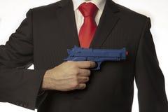 Uomo d'affari con una pistola Fotografia Stock Libera da Diritti