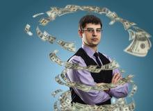Uomo d'affari con vortice dei soldi immagini stock