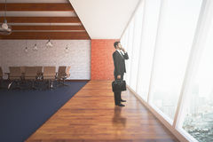 Uomo d'affari In Conference Room Fotografia Stock Libera da Diritti
