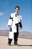 Uomo d'affari coperto di documenti fotografia stock