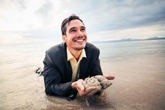 Uomo d'affari Crawling To Safety fotografia stock libera da diritti