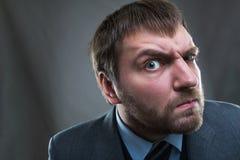 Uomo d'affari curioso Fotografie Stock