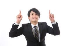Uomo d'affari da indicare a Immagine Stock