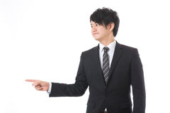 Uomo d'affari da indicare a Fotografie Stock