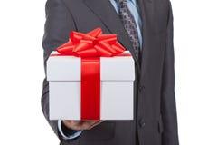 Uomo d'affari del contenitore di regalo Fotografie Stock