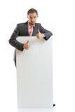 Uomo d'affari del legame del vestito che visualizza cartello immagini stock libere da diritti