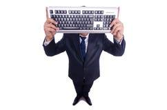 Uomo d'affari del nerd con la tastiera di computer Fotografia Stock