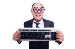 Uomo d'affari del nerd con la tastiera di computer Immagini Stock Libere da Diritti