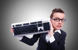 Uomo d'affari del nerd con la tastiera di computer su bianco Immagini Stock Libere da Diritti