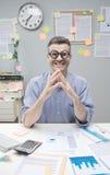 Uomo d'affari del nerd sul lavoro Fotografia Stock