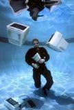 Uomo d'affari dentro sopra la sua parte 1 capa Fotografia Stock