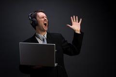 Uomo d'affari di canto Fotografia Stock