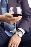 Uomo d'affari di classe con una bevanda Fotografia Stock