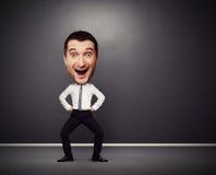 Uomo d'affari di dancing con la grande testa Fotografia Stock