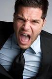Uomo d'affari di grido Fotografie Stock
