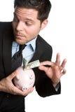 Uomo d'affari di Piggybank Fotografia Stock Libera da Diritti