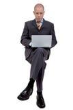 Uomo d'affari di seduta Fotografie Stock