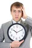 Uomo d'affari di Shoked che tiene un orologio Immagini Stock