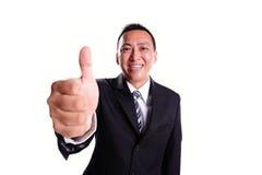 Uomo d'affari di sorriso con il pollice su Fotografia Stock