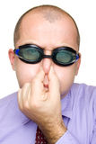 Uomo d'affari divertente con gli occhiali di protezione di nuoto Immagini Stock