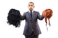 Uomo d'affari divertente con la parrucca femminile isolata Immagini Stock