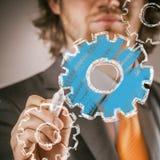 Uomo d'affari Drawing Conceptual Gears su vetro illustrazione di stock