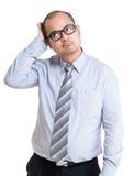 Uomo d'affari duro per prendere decisione Immagini Stock