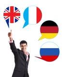 Uomo d'affari e bolle con le bandiere di paesi Fotografia Stock