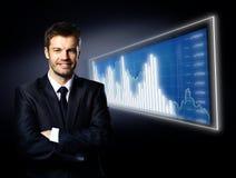 Uomo d'affari e diagramma blu Fotografia Stock