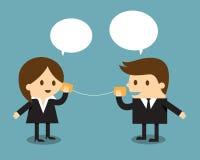 Uomo d'affari e donna che parlano con il telefono della latta Immagine Stock