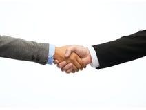 Uomo d'affari e donna di affari che stringono le mani immagini stock libere da diritti