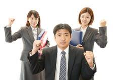 Uomo d'affari e donne di affari che godono del successo Fotografia Stock
