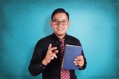 Uomo d'affari e libro Fotografia Stock