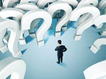 Uomo d'affari e molte domande Fotografie Stock Libere da Diritti