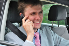 Uomo d'affari e telefono mobile Immagini Stock Libere da Diritti