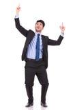 Uomo d'affari emozionante che indica le dita e cercare Fotografia Stock Libera da Diritti