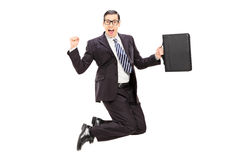 Uomo d'affari emozionante che salta con la gioia Fotografie Stock Libere da Diritti