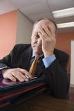 Uomo d'affari esaurito Immagine Stock