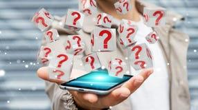Uomo d'affari facendo uso dei cubi con i punti interrogativi della rappresentazione 3D Immagini Stock